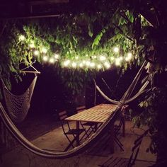 outdoor patio lights (1) I would love a lounging area like this with multiple hammocks. Love it!