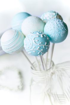 Blue cake pops with white decoration