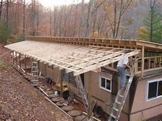 Environmentally Friendly Houses - The Ultimate Green Mobile Home - papercrete tire bricks used in green, environmentally friendly mobile home remodel - Mobile Home Roof, Mobile Home Exteriors, Mobile Home Repair, Mobile Home Renovations, Mobile Home Makeovers, Mobile Home Living, Remodeling Mobile Homes, Home Remodeling, Remodeling Costs
