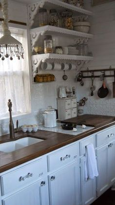 A Joyful Cottage: Living Large In Small Spaces - A Tour of Shabby Chic Tiny Retreat .... the kitchen is really pretty, a vintage look!