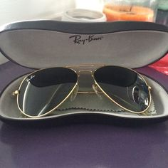 "RAY BAN AVIATORS, gold, authentic! These are a pair of authentic ray ban aviators. I tried to take a picture of the RB engraved on the side lens, can sorta see it in the pic. They are RB 3025. Then it says ""AVIATORL W3276 58014"". They are in great condition a small show little signs of wear. I wore them on occasion for one Summer's time. No scratches I switched the soft case to a Ray ban hard case so they wouldn't get smashed in my purse. Comes with Ray ban cleaning clothe as well!:) Ray-Ban…"