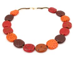Beautiful Kazuri beads handmade from earthen clay , fired and hand painted by Kenyan women