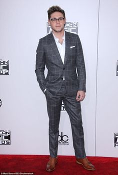 Hunky heartthrob! The X Factor contestant looked dapper in a charcoal grey fitted suit as ...