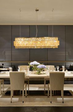 Fendi Casa warm living room design with Crystal Baguette lighting in bronze shadow metal Luxury Living Group
