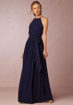 Looking for something a bit different for your ladies? Look no further than this elegant chiffon dress. Dipped in the prettiest hues, the high neck and long, sweeping skirt lend loads of romance and femininity to this look.