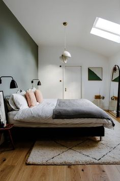 A bedroom with a green statement wall