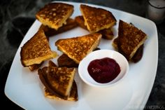 Mini grilled cheese with ketchup.