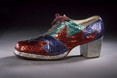 This type of men's shoe was fashionable in the 1970s. They are made of a patchwork of snakeskin leather in iridescent metallic colors. They have platform soles and high heels with a blunt square toe. Platform shoes were worn by both men and women. The more flamboyant rock stars of the day, such as David Bowie and Elton John, wore the most extreme examples. (The Victoria & Albert Museum)