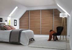 Bespoke fitted wardrobes make the best use of every inch of space in a bedroom.   These sliding wardrobes are shown in rich Nocino finish. Perfect for a loft conversion