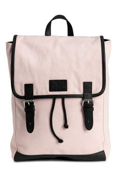 Backpack in cotton canvas with imitation leather details and a handle and concealed drawstring at the top. Narrow adjustable shoulder straps, one outer comp