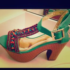 """Reduced $10!! C. Label Beaded Wedge Sandals New This is a gorgeous pair of sandals by C. Label. They are made of faux green leather with beads and stones on the front in shades of green, gold, orange and amber. They are a size 6 with a 4.75"""" heel and a 2.5"""" platform. C. Label Shoes Wedges"""