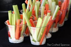 Celery, carrots and ranch dressing at the bottom