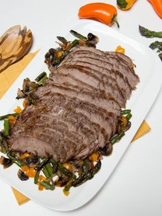 This beef flank recipe is outrageously simple and at the same time, it serves a fancy dinner. If you were to order something like this at restaurant, it can get ridiculously expensive. Little that we know, is how simple preparing good steak at home can be. The juice of the baking steak, floats over the vegetables and the aroma is beyond heavenly. All you need, is some good salt to season the beef for great flavor results, because when it comes to flavor, a cut like flank, speaks for itself.
