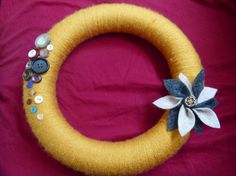 Yellow yarn wreath