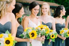 sunflower wedding bouquets and gray bridesmaids dresses | Magnolia plantation wedding in Charleston SC by Catherine Ann Photography | www.catherineannphotography.com