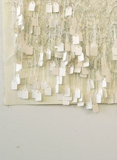 Little price tags on a cool neutral backdrop would make interesting escort cards...