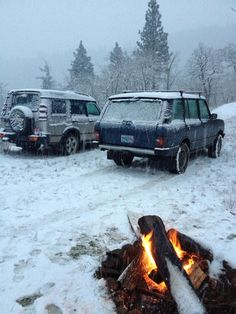 Range Rover Classic and Discovery in the snow outside of Lyle Washington. Ponderosa Pine in the background. Camp fire.