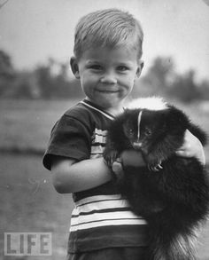 Brave boy to play with this skunk. From our gallery: Kids and Their Pets