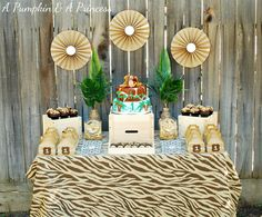 Southern Blue Celebrations: Jungle, Safari, Zoo Party Ideas and Inspirations - love the printed tablecloth.
