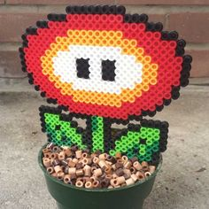 Your favorite Mario power up is now available as the ultimate geeky home decoration! Each plant is made entirely from Perler beads and sealed in a pot to recreate the classic 8-bit Fire Flowers seen in the Super Mario Bros.