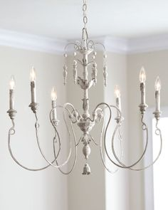 "Spindly, asymmetrical chandelier with leaf and vine motif. Handcrafted of steel and polyresin. Hand-painted, distressed, ""Persian White"" finish. Uses six 60-watt bulbs. Includes ceiling canopy. Direct"