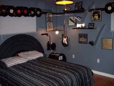 Music theme room with pictures, drum, electric guitar, and disk
