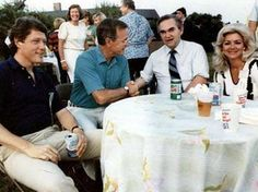 Wallace and his third wife, the former Lisa Taylor, meet with Vice President George Bush and Arkansas Gov. Bill Clinton at a lobster bake at Bush's residence at Kennebunkport, Maine, July 30, 1983. The third Mrs. Wallace, whom the governor married in 1981, was 30 years his junior and half of a country-western singing duo, Mona and Lisa, who had performed during his campaign in 1968.
