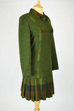 This classic vintage dress is by Yi King Fashion, and is made of a green woven fabric with check detail and a pleated skirt. Yi King, Green Pleated Skirt, King Fashion, Woven Fabric, Vintage Dresses, 1960s, Bell Sleeve Top, Detail, Classic