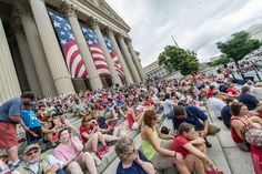 Hundreds of guests take a front row seat on the steps of the National Archives.