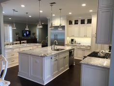 Our kitchen renovation: Double Island, Thermador Pro Series appliances and custom cabinets. Wall color: Benjamin Moore Quiet Moments Granite: Viscount White
