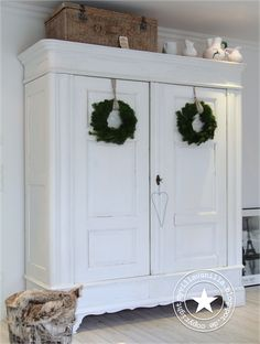 Green wreath against white Armoire! Simply perfect!