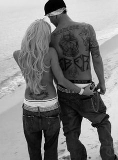 Tattooed couple on the beach...I have this thing for tattoos.