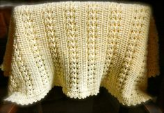 Simple and sweet baby blanket for that special little girl. Pattern is suitable for advanced beginners and is customizable for your choice of yarn and gauge and finishes size.