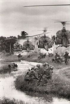 U.S. helicopters drop-off reinforcements in the Mekong Delta. Saigon, South Vietnam, August 1967. (AP Photo)