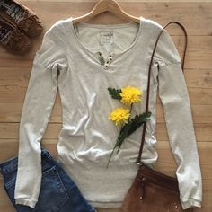 "| Free People Top  Free People's ""We The Free"" label.  Cream long sleeve top with metal embellishments and banded around bottom.  In gently used condition. Free People Tops"