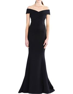Brimming with vintage glamour, this off-the-shoulder gown from Rachel Gilbert is made in scuba neoprene with an hourglass shape, a flared floor length hem and an elegant V back.