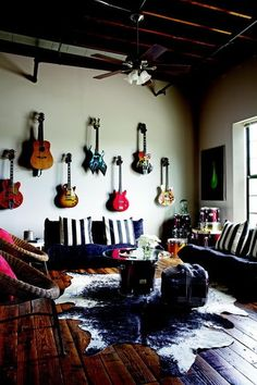 guitar wall and drums in corner and overall rawness of this room - musical and edgy