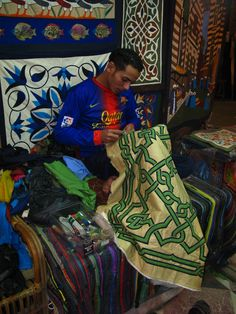 Mohamed is one of only a few young stitchers taking up the art if the Khiamiah. He is being taught by Essam Ali.