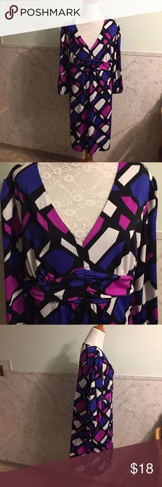 "NY Collection Stretchy High Waisted Vibrant Dress This is a cute v-neckline with a gathered high waistline in the center. It's a stretchy polyester and spandex and has elastic at the ends of the sleeves. It's a size XL. Length is 38.5"". It's a vibrant magenta and blue highlighted with white against black. NY Collection Dresses"