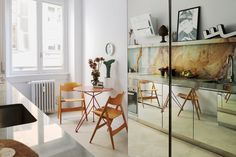 In the kitchen, 1950s Egon Eiermann folding chairs, mirrored cabinets and vintage Arabic signage.