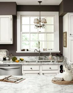 Love the wall color with white cabinets