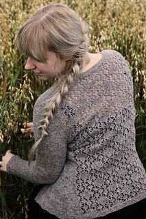 Uan is a woolly cardigan with fitted full-length sleeves. It is otherwise plain stockinette stitch but the back has a beautiful lace panel.