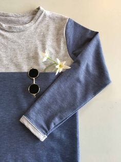 The H & G's Top has a yoke panel with a hidden pocket in the seam. Binding finishes off the neckline and sleeves, a scooped hem finishes the funky look. Sewing Patterns For Kids, Double Knitting, Knitted Fabric, Size 2, Neckline, Pocket, Sleeves, Clothes, Tops
