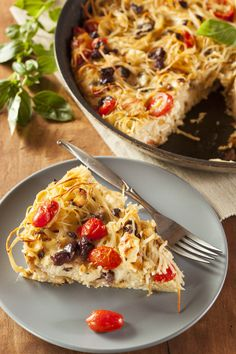 Cooked spaghetti is baked into a pie with ricotta, parmesan and eggs, along with cherry tomatoes and red onions in this simple recipe perfect for lunchboxes or for a family dinner. #Cheesy #Baked #Spaghetti #Pie With #Roasted #Cherry #Tomatoes