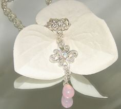 Swarovski Elements Pink Opal Czech Glass Briolette Drop Necklace Silver 18 Inch w Extension Pink AB CrystalRemember playing dress up as a girl with your mother's jewelry and clothes?  Looking in the mirror at how pretty you looked?  I wanted to tap into that little girl that's still insi...