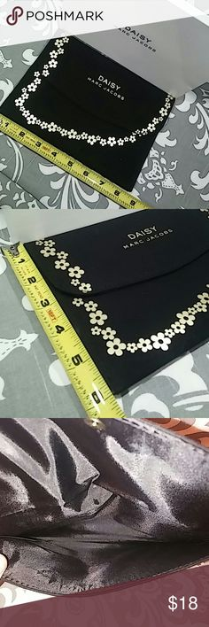 NIB Marc Jacobs Daisy Pouch Black canvas like material with gold flowers and lettering Never used Comes in box Bundle & Save!! Marc Jacobs Bags