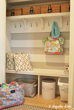 Create a mudroom area from an existing closet using hooks, shelving, baskets and bags. Isn't this a fabulous and perfect solution for back-to-school season?