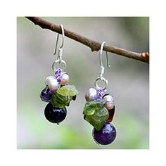 @Overstock.com - Silver Garnet/ Amethyst Bright Bouquet Earrings (Thailand) - These silver amethyst earrings are hand-knotted on silken strands in Thailand. The Bright Bouquet earrings feature a stunning mix of garnets, amethysts, peridots, and pearls. The beautiful sterling silver hook earrings are 15.24 x 35.56 mm.  http://www.overstock.com/Worldstock-Fair-Trade/Silver-Garnet-Amethyst-Bright-Bouquet-Earrings-Thailand/4068368/product.html?CID=214117 $18.49