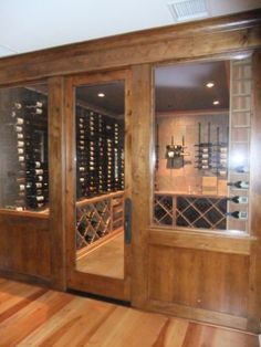 This one was created and installed for one of the most unique wine cellar projects we did. The details of the project are featured on this page - www. Glass Wine Cellar, Home Wine Cellars, Wine Cellar Design, Wine Glass, Modern Restaurant Design, Cigar Room, Memphis Tennessee, Unique Doors, Wine Storage