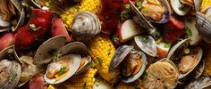 Learn how to make a New England clam boil in a big pot, complete with Portuguese sausage.